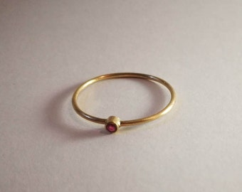 Delicate 9ct gold and ruby ring