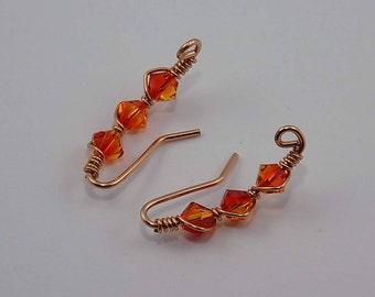 Swarovski crystals, brilliant orange, yellow, copper, ear vines.