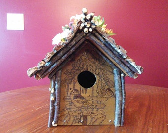 Wood burned birdhouse