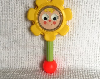 Vintage Fisher Price Flower Rattle with Happy Face - An adorable classic for Baby