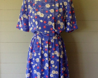 1980s Beautiful Blue Floral Dress/Double Breasted Bodice with Hidden Buttons Down Front of Gathered Skirt/Fabric is Feels like Silk