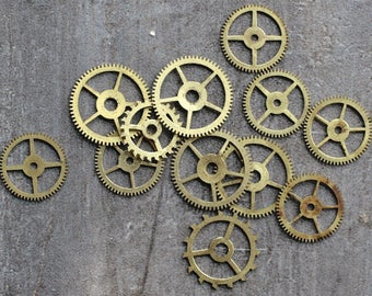 Vintage clock brass gears -- set of 12 -- D3