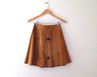 1960s thick suede yellow ochre mini skirt with wooden buttons , size small