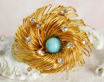 Vintage Bird's Nest Brooch in Gold Tone Metal with Clear Rhinestones and Blue Bead