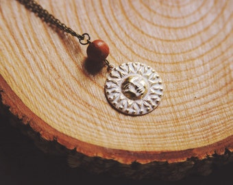 golden sun necklace.