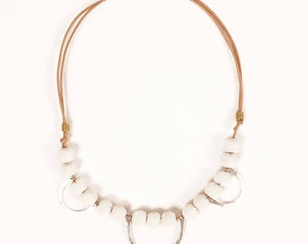 Bronze arcs and white greek ceramic beads on leather cord necklace | MORRISON