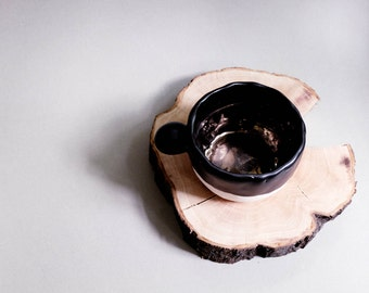 Ceramic handbuilt tea cup inspired by wabi sabi in matte black and gold