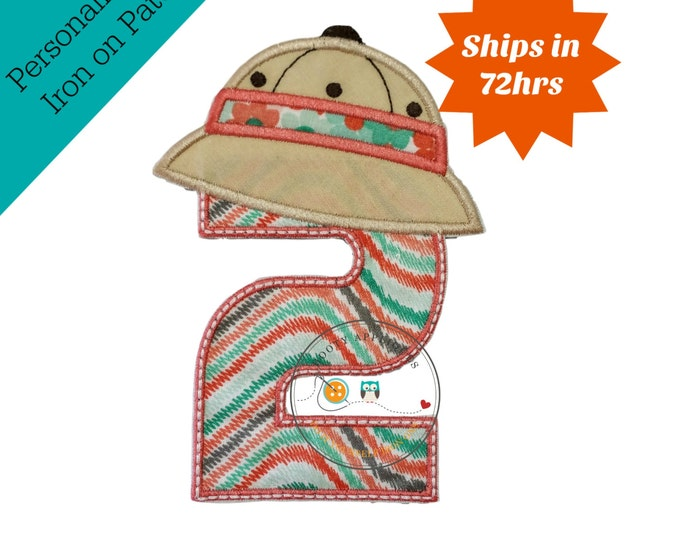 Safari themed girl's birthday number two with coral, green, gray, & white print. Number two trimmed in warm coral. Khaki zoo hat tops number