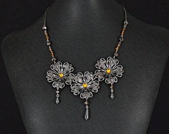 Gunmetal Victorian Steampunk filigree necklace with amber colored beads and crystals by Sylvan Creations.