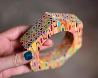 Hexagonal bangle bracelet made of colored pencils.