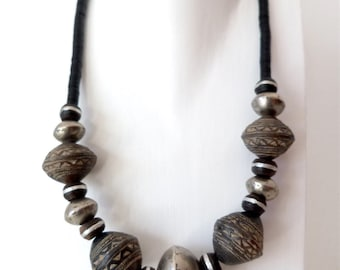 African necklace made of bakelite tiles, ceramic beads, and Tuareg silver beads