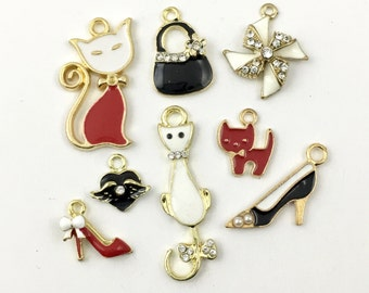 8 charms collection gold tone and enamel,15mm to 36mm  #ENSA 150