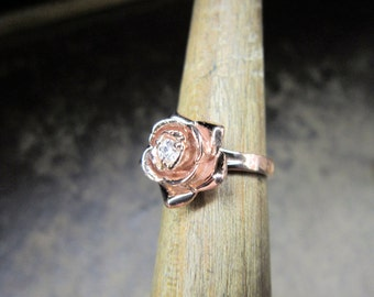 Rose ring with a diamond