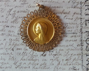 Vintage golden metal  French Virgin Mary Medal. Religious pendant.
