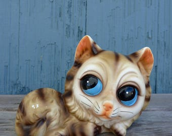 Big Eyed tabby cat figurine by Norleans of Japan, featuring big blue eyes, reminiscent of Margaret Keane