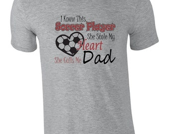 Soccer dad shirt.  Proud soccer dad t shirt. Soccer player stole my heart, she calls me dad.  Pink pig printing
