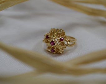 Ornate and regal vintage 14K yellow gold ring with elegant Rubies