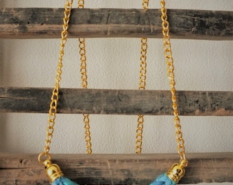 Blue knitting wool and brass necklace