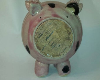 Spotted flying piggy bank