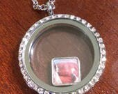 Reserved listing for Kelly - One floating locket charm
