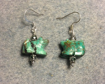 Carved turquoise gemstone dog bead earrings adorned with turquoise Chinese crystal beads.