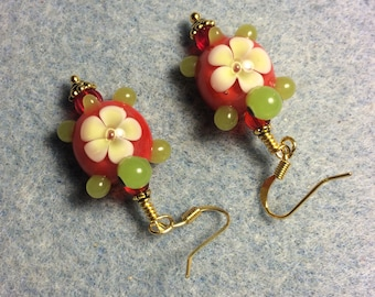 Red and green lampwork turtle bead dangle earrings adorned with red Czech glass beads.