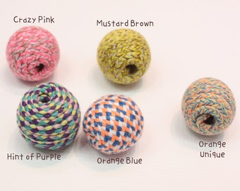 String covered wood balls in crazy mixed colors