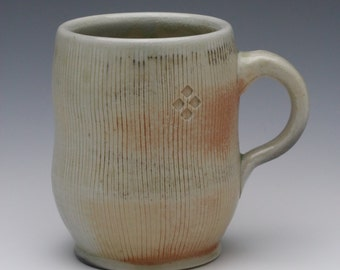 Kazegama fired, ash glazed porcelain mug with brushed and stamped texture, 12 oz.