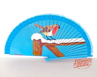 Fan blue of wood with a Robin in the snow painted hand, fan Spanish painted by hand