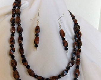 Double strand glass bead necklace with matching earrings