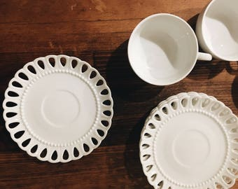 Vintage white ceramic teacups and saucers