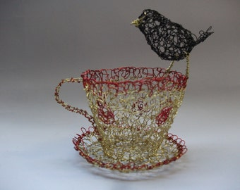 Vintage style teacup with blackbird
