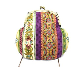 Plum bag with a metal clasp, patterned with gold stripes and pink flowers