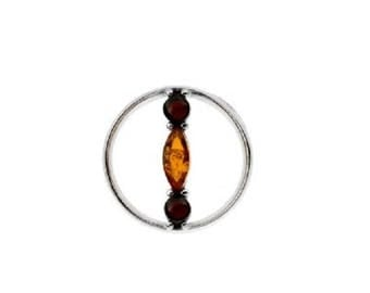 Pendant in bicoloured amber on rhodium 925 silver.