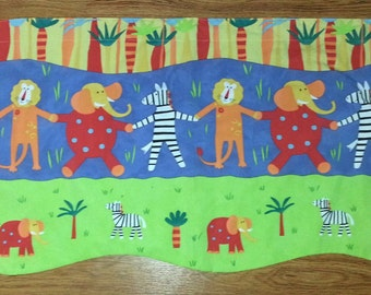 Scandinavian designed children curtain coat / valance with elephant,zebra and lion in lovely design from Sweden.
