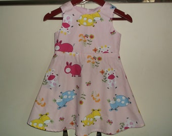 Crazy pigs and ponies on pink dress