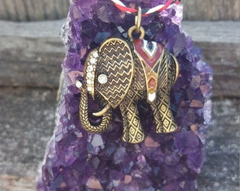 Bronze Elephant with Red, Black, White and Sparkly Details Charm on Braided Red, White and Black Hemp Cord Neckalce