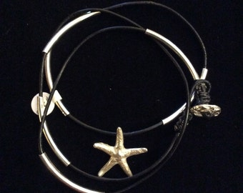 Black leather and silver tube and silver starfish bracelet