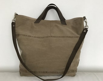 Large light brown repurposed cotton tote bag with leather strap and handles