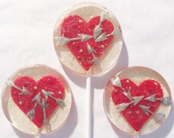3 Natural Chocolate And Raspberry Flavored Hearts And Arrows Lollipops