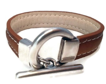 Bracelet leather color choice, White Leather lined, white pique, antique silver plated clasp.