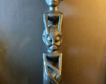 Vintage hand carved indonesian tribe statue with real hair.