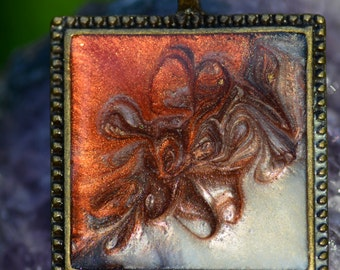 Square resin pendant with bronze and pink swirls