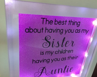 "Light up frame with quote ""The best thing about having you as a sister"""