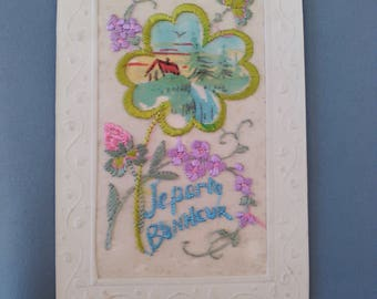 "Embroidered postcard ""Good-luck charm"" years 10/20 with a written and stamped 4-leaf clover"