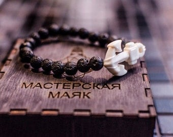 A bracelet made of volcanic lava and the bones of a bull, a bracelet with anchor