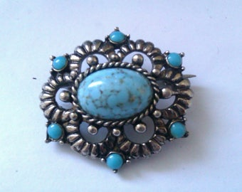 silver coloured brooch