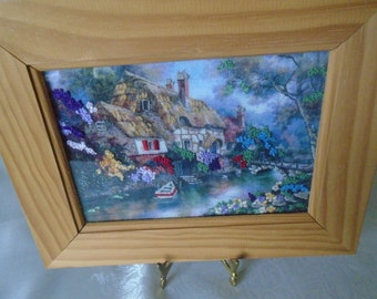 3- D embroidery cottage and river scene