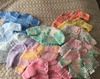 Baby sweaters,crocheted acrylic in Easter Colors