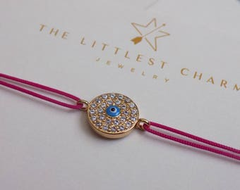 Evil eye bracelet with cubic zirconia on string. Delicate bracelet with cubic zirconia for protection and everyday use.